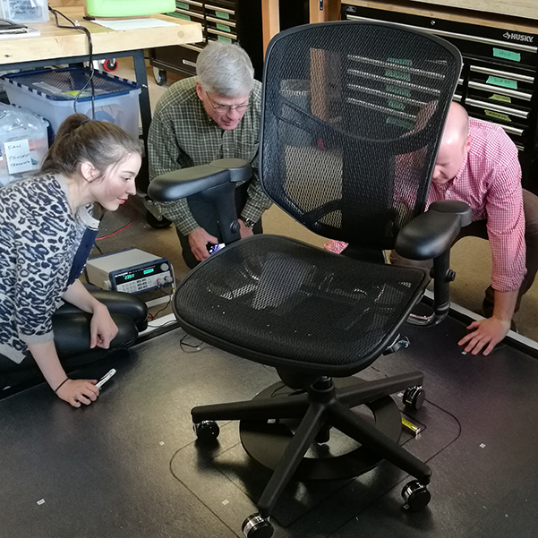 Wireless power personal comfort chair team in lab